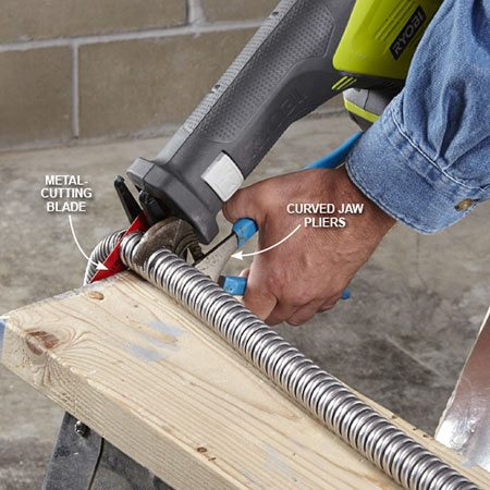 <b>Photo 2: Cut and secure the conduit</b></br> Measure out the length needed to span the space between the electrical box and the water heater. Clamp the flex conduit to a sawhorse using a curved-jaw pliers. Then cut straight through the conduit to get a square edge. Remove burrs and attach the connector.