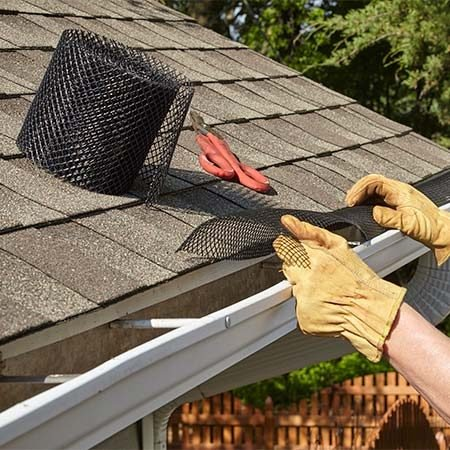 <b>Simple to install</b></br> <p>Plastic drop-in screens like this are super easy to install. Just cut them into sections and wedge them into place between the gutter and the fascia—no fastening necessary.</p>  <p><b>Frost King Plastic Gutter Guard, 10¢ per foot, available at home centers.</b></p>