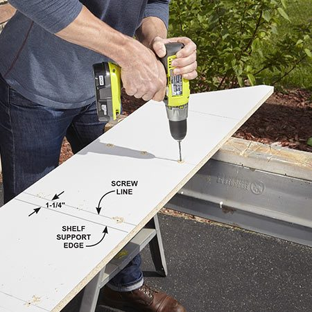<b>Photo 2: Mark and drill</b></br> Mark where the edge of each shelf support is located and mark a centerline for screw locations. Drill three 9/64-in. screw holes for each support.