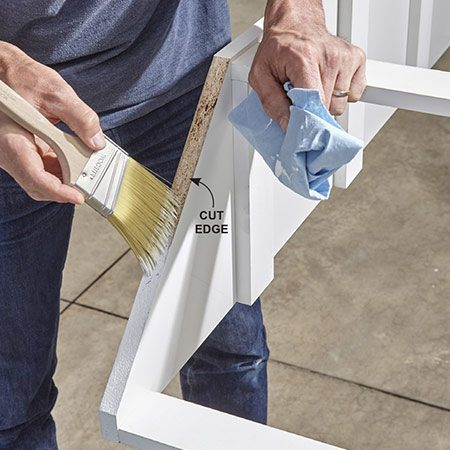 <b>Photo 6: Paint the cut edges</b></br> For looks and moisture protection, apply two coats of paint. If you slop a little paint onto the melamine surface, just wipe it off with a damp rag.