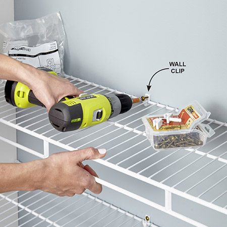 <b>Photo 11: Anchor the shelves</b></br> Fasten each shelf to the wall with at least two clips. When you want to fasten the clip to a stud, simply cut off the drywall anchor part of the clip and drive a screw through the clip.