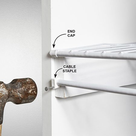 <b>Photo 12: Fasten the shelf fronts</b></br> Lock the shelves in place with coaxial cable staples. End caps give the shelves a finished look.