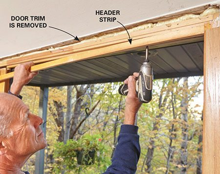 <b>Photo 1: Unscrew and Remove the Header</b></br> <p>Open the patio door so the sliding door is in front of the stationary section. Start removing the header screws from that end. As you reach the open part of the door, have a friend brace the movable door so it doesn't tip out. Then remove the entire header strip. (If the door trim overlaps the header strip, you'll have to remove it.)</p>