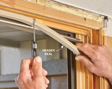 <b>Photo 5: Remove the header seal</b></br> <p>Starting at one side, slide a hook or pick behind the header seal and pry it away from the wood. Then slide the pick along the header as you pull off the entire header seal.</p>