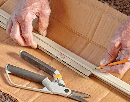<b>Photo 6: Cut the new seals</b></br> <p>Using the old seals as templates, mark and cut the new seals to the proper length. Cut with a scissors, utility knife or hacksaw.</p>