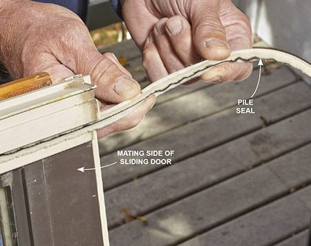 <b>Photo 8: Install the new mating seal</b></br> <p>Slide the new pile seal into the groove on the mating side of the sliding door. Then attach new self-adhesive pile trips at the top and bottom of the stationary door.</p>