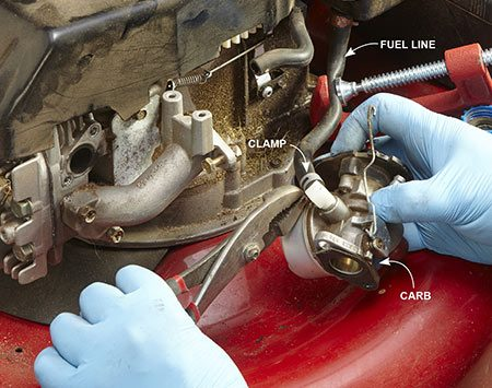 <b>Photo 3: Replace the carb</b></br> <p>Tighten a C-clamp on the gas line or turn the shutoff valve to Off. Then remove the fuel line and two carburetor hold-down bolts. Rotate the carburetor to disconnect the throttle linkage. Reverse the procedure to install the new carburetor.</p>