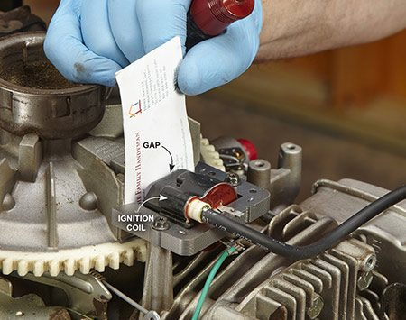 <b>Photo 5: Install the new coil</b></br> <p>Set the new coil in place and snug the retaining screws, but don't tighten them all the way. Align the crankshaft magnet to the center of the coil. Set the air gap using a business card as a gauge. Move the coil in and out until you feel a slight drag on the card. Then tighten the coil screws. Check the gap again. If it's right, reinstall the engine shield and cover.</p>