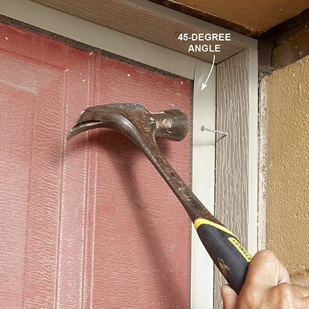 <b><b>Photo 4:</b> Test-fit the doorstop</b></br> <p>Place the doorstop against the top and side jambs so the vinyl weather stripping is at a 45-degree angle. Temporarily secure it in place with nails pounded in only partway.</p>