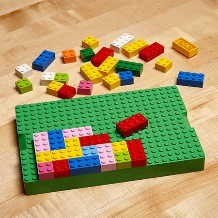 <b><b>Photo 1:</b> Design with Legos blocks</b></br> <p>Here's an easy way to design your wall unit: Use LEGO blocks to represent single and double boxes. Take photos of various patterns, then compare the photos to decide which arrangement works best.</p>