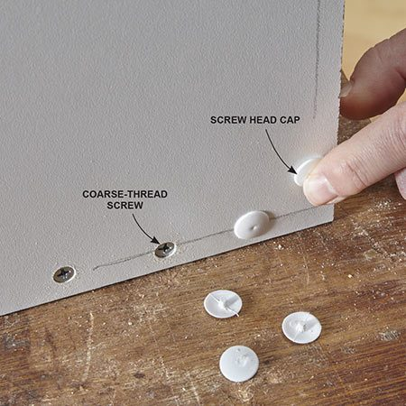 """<b>Hide the screw heads</b></br> <p>The home center where we bought our melamine panels sells small bags of screws—labeled """"melamine screws"""" — that are packaged with white plastic caps to hide the screw heads. You just press them on with a finger, then give each one a light tap with a hammer.</p>"""