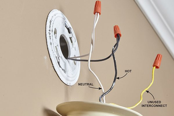 <p>A hardwired smoke detector is powered by your home's electrical system. If yours is connected to only two wires, it's not interconnected (see below).</p>