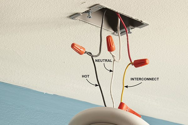 <p>A hardwired detector that's connected to three wires is interconnected with other detectors. If one senses smoke, they all scream.</p>