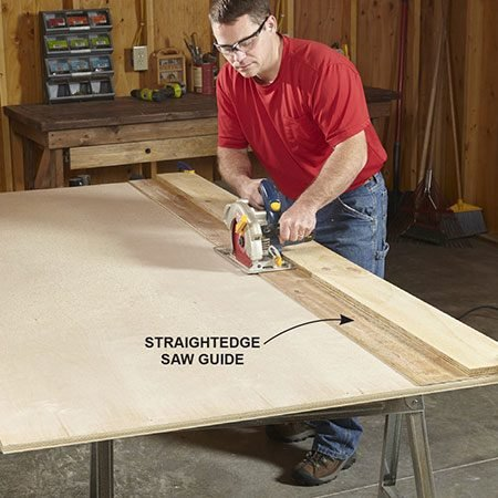 """<b>Photo 1: Cut plywood sheets into strips</b></br> <p>Mark the width of the cut on both ends of the sheet. Align the ends of the straightedge guide with the marks and clamp the ends. Make sure to place the guide on the """"keeper"""" side of the marks. Run the saw along the guide to complete the cut.</p>"""