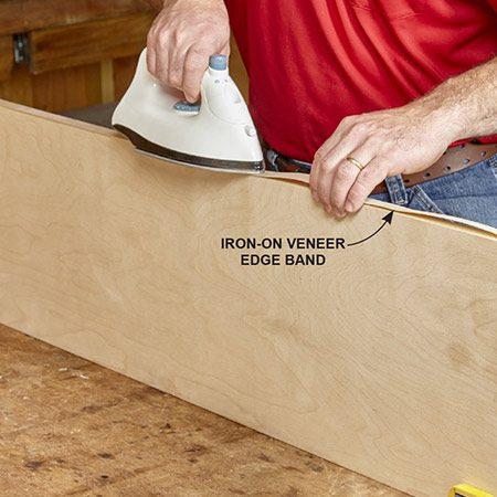 <b>Photo 4: Apply edge banding with an iron</b></br> <p>Cut iron-on edge banding about an inch longer than you need. Center the strip on the edge of the plywood and iron it on. Keep the iron moving. As soon as you're done applying heat, rub over the entire surface with a small chunk of wood to ensure good adhesion. Trim off the overhanging ends with a sharp utility knife.</p>
