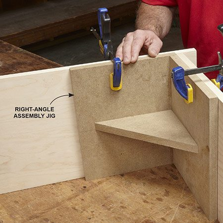 <b>Photo 6: Hold the box parts square</b></br> <p>It's a lot easier to assemble the pieces if you have a right-angle jig to hold them steady while you drill pilot holes and drive screws. Make the jig out of scraps of plywood. Then line up the parts and clamp them to the jig.</p>