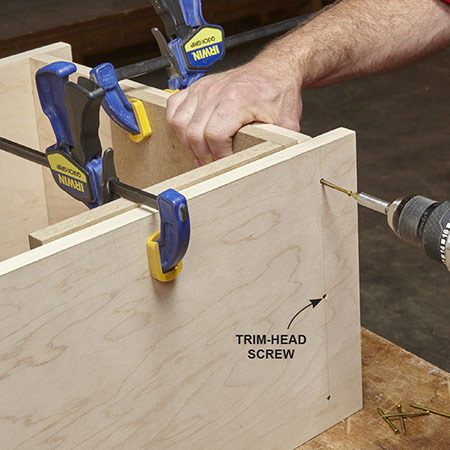 <b>Photo 7: Assemble shelves with screws</b></br> <p>For easy assembly, join the sides to the tops and bottoms with trimhead screws. Drill 1/8-in. pilot holes first. Then drive the screws until the heads are slightly recessed. After the first coat of finish, fill the screw head recesses with soft wood putty to match the stain and cover with a final coat of finish.</p>