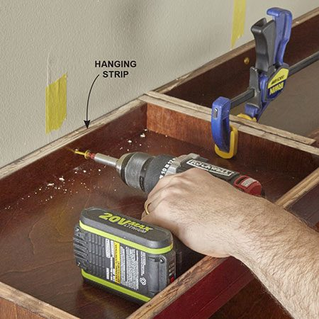 <b>Photo 10: Add the end nuts</b></br> <p>Align the top of the outside shelf unit with the top of the center shelf unit. Make sure the top is level. Then drive screws through the hanging cleat into wall studs to support it. Center the decorative brackets under the shelf and attach them to the wall studs with screws.</p>
