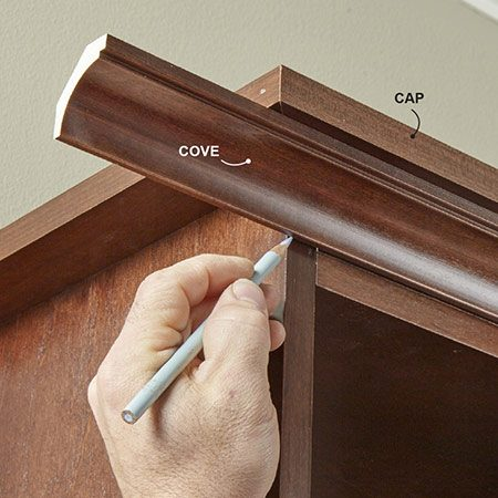 <b>Photo 11: Install the cove molding</b></br> <p>Finish up by installing the cap and cove molding to the tops of the cabinets. Miter the inside and outside corners. We used a finish nail gun, but you can also drill pilot holes and attach the moldings with trim nails. Fill the nail holes with soft putty to match the stain.</p>