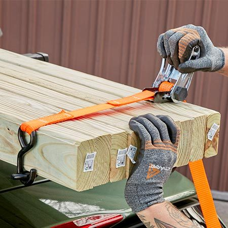 <b>Photo 1: Secure the load to itself</b></br> <p>Wrap the straps around the lumber bundle at the front and rear. Then tighten until you can't move the middle pieces.</p>