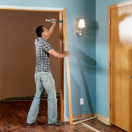 <b>Photo 1: Remove the old window and door trim</b></br> Pry off the old trim and pull out any nails remaining in the doorjambs and window jambs. If there's a ridge of paint or finish on the face of the jambs, sand it smooth to prepare for the new trim.
