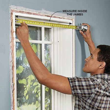<b>Photo 2: Measure between the jambs</b></br> Make a list of the windows and doors that need new trim. Then measure the width between the jambs and write these measurements on your list.
