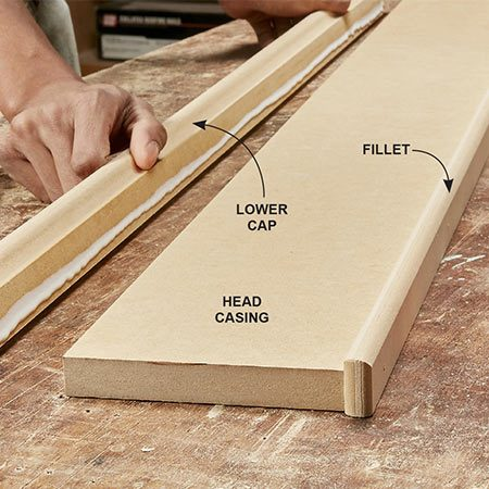 <b>Photo 7: Build the head casing assembly</b></br> Collect the four parts for the head casing and arrange them on your work surface. Spread glue along meeting edges and pin them together with 1-1/2-in. trim nails. Before nailing them together, make sure to align the parts so the end reveals (overhangs) are even.