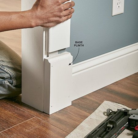 <b>Photo 12: Make base plinths for the doors</b></br> Complete the classic look by adding plinth blocks under the side casings on doors and other openings. Make the 1-1/4-in.-thick plinths by gluing strips of 1/2-in.- and 3/4-in.-thick MDF together. Then rout a cove on the top edge. Make the plinths about 1/4 in. wider than the casing to create a small offset where the casing rests on the blocks.