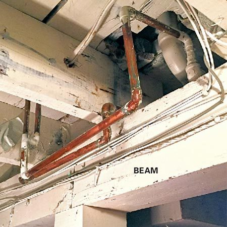 <b>Check from the basement to see what's in the wall</b></br> <p>Look for pipes, ducts and wiring that run up into the wall. If you discover plumbing, heat ducts or wiring and aren't sure whether relocating them is a DIY project, call in a pro to get an estimate of the work involved and what it will cost.</p>