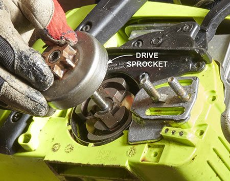 <b>Photo 5: Remove the Drive Sprocket</b></br> Use a small flat-blade screwdriver to remove the driveshaft E-clip. Then lift off the old sprocket. To install a new sprocket, slip it into place and snap on the E-clip with a needle-nose pliers.