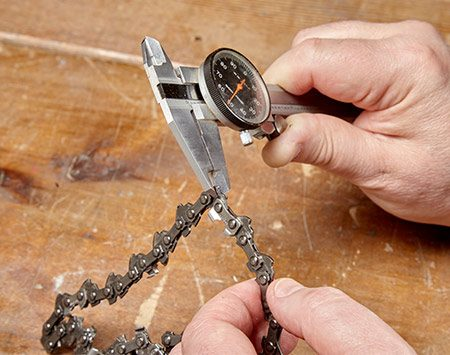 <p><b>Measure the drive link thickness</b></p> <p>The chain gauge may be stamped into the drive links. If not, measure a drive link gauge with a micrometer or vernier caliper as shown above. Common sizes are .043, .050, .058 and 063 in. This one measures .050 in. Then count the number of drive links. This one has 62.</p>