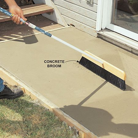 <b>Add texture with a broom</b></br> Use a special concrete broom or any stiff-bristle broom about 15 minutes after floating to add a slip-resistant texture to the top of the pad. The coarser you want the texture, the earlier you should broom. The grooves created by the broom should follow the direction of the slope so water runs off easily. Brooming also hides imperfections in float work.
