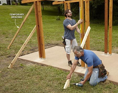 <b>Photo 8: Plumb and Brace the Posts</b></br> <p>Stand up one side of the grillzebo and fasten the posts to the bases. Make sure all the posts are plumb as you add temporary braces.</p>