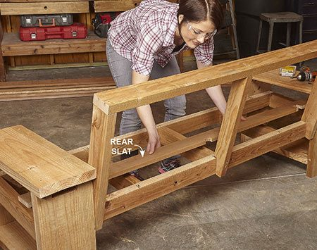 <b>Photo 7: Install the seat slats</b></br> Cut notches in the front and rear slats to fit around the front legs and back braces. After the front and rear slats are installed, space the other three slats evenly between them.