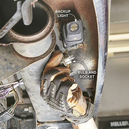 <b>Photo 2: Twist and remove the bulb sockets</b></br> <p>Twist each license plate bulb socket a quarter turn and pull them straight out of the light assembly. Set them aside.</p>