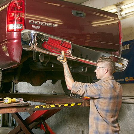 <b>Photo 7: Install the bumper</b></br> <p>Lift the new bumper into place and loosely attach the bumper brackets to the frame brackets. Align the bumper with the bolt holes in the bed and insert all the bolts. Then tighten all the bolts to the manufacturer's specifications.</p>