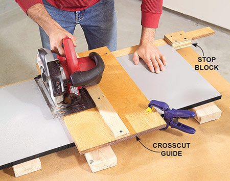 <b>Photo 5: Crosscut the parts</b></br> <p>Cut parts to length using a crosscut guide. A stop block screwed to the guide lets you mass-produce identical lengths fast. Support the melamine on both sides of the cut with 2x4 scraps.</p>