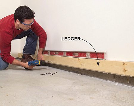 <b>Photo 10: Install a ledger</b></br> <p>Fasten a 2x4 ledger to the wall framing with 3-in. screws. Choose a straight 2x4 and make sure the ledger is level.</p>