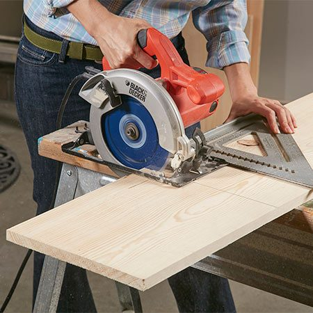 <b>Photo 1: Cut the parts</b></br> <p>Cut the boards to length, following the Cutting List. Running your circular saw along a large square ensures straight, square cuts. Parts F, G and N also have to be ripped to width. You can do this with your circular saw or on a table saw.</p>