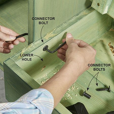 <b>Photo 12: Connect the bench and shelf</b></br> <p>Use two-part connector bolts to connect the front of the bench to the shelves on each side (connect the second side later after the second shelf is mounted). These bolts provide more support than screws to ensure the bench will be safe to sit on. The bolts we used required two Allen wrenches to tighten.</p>