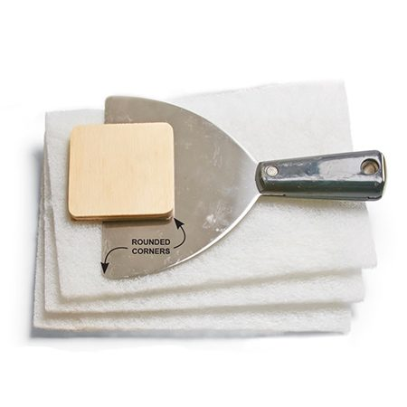 <b>Furniture-friendly scrappers/Abrasive pad</b></br> <p>Use a wide putty knife to scoop the finish off once the stripper has softened it. Be sure to round off the corners of the putty knife with a file or electric grinder to prevent gouging of the wood. A 3-in. x 3-in. piece of 1/4-in. plywood with the corners rounded off also makes a good scraping tool.</p> <p>Use plastic scouring pads to gently remove leftover stripper and residue after scraping. Avoid using steel wool, especially with water-based strippers, because it can leave rust marks behind.</p>