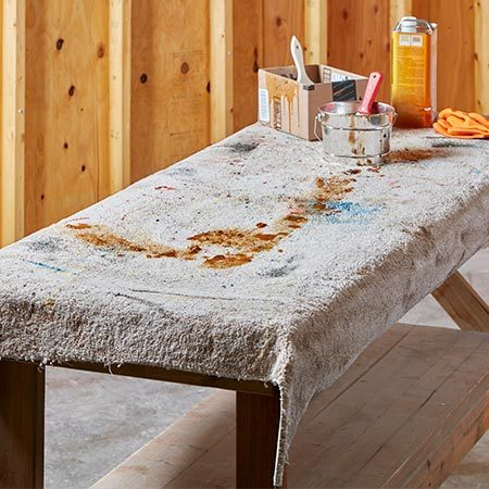 <b>Carpet your workbench</b></br> <p>A piece of used carpeting or a new carpet remnant on a table or workbench makes a great surface for stripping furniture. The soft carpet protects wood from nicks and scratches and also absorbs drips. You can also use a tarp, plastic drop cloth or old newspapers.</p>