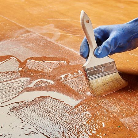 <b>Brush it on thick</b></br> <p>Many strippers go on like a gel, so don't be afraid to get it on thick—1/8 in. to 1/4 in. Add a second coat if the first one dries before you have time to scrape it off, or if the finish doesn't all come off the first time.</p>