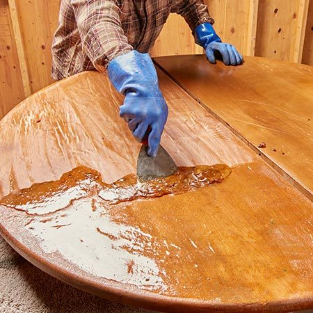 "<b>Strip in zones</b></br> <p>When stripping a really large piece of furniture, do it in ""zones."" Only apply stripper to part of the piece and scrape it off before the stripper dries.</p>"