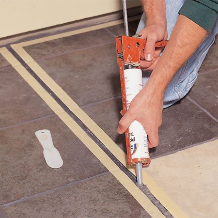 <b>Photo 5: Seal expansion joints</b></br> <p>Seal expansion joints with caulk after cleaning them out well (vacuuming them is a quick, thorough method). To make a neat joint, mask the tile along both sides and smooth the caulk with a rounded putty knife. You can round the blade of a plastic putty knife using a utility knife and sandpaper.</p>