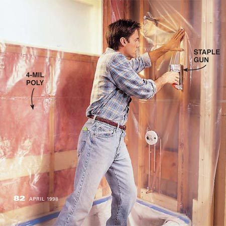 <b>Photo 3: Add the vapor barrier</b><br/>Staple 4-mil plastic sheeting to the framing. Drape the plastic into the tub and cut it off after the cement board is installed.
