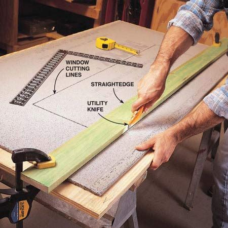 <b>Photo 5: Score </b></br> Mark the next sheet for cutting. Clamp a straightedge along the cutting line, and use it as a guide to score the cement board with a utility knife. Score the full length of the sheet about five or six times using firm downward pressure.