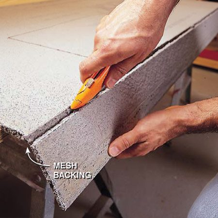 <b>Snap </b><br/>Snap the board along the scored line by laying it over the edge of your work surface and pressing down. Hold the broken-off piece while you cut through the fiberglass mat on the back.