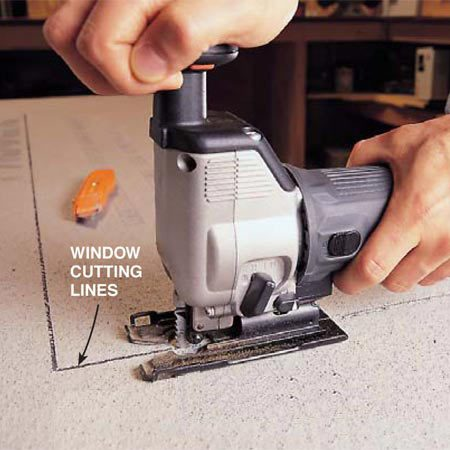 <b>Photo 6: Use a jigsaw to cut shapes</b><br/>Saw the two sides of the window notch using a jigsaw. Then score and break out the remainder using the procedures we showed in Photo 5.