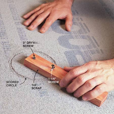 "<b>Photo 9: Punch out large holes</b></br> Construct a homemade circle cutter for larger holes. Drill a small hole in one end of a scrap of wood, attach it to the cement board at the center of the circle, screwing through the cement board into the work surface below. Then screw in a ""cutter"" screw where you want the circle to be scored, for example, 2 in. from the center for a 4-in. hole. Allow the point to stick out the bottom. Spin the cutter while applying pressure to score a perfect circle. Repeat the process on the other side. As shown in the inset photo, pound out the circle with your hammer. Be careful not to damage the edge of the hole."